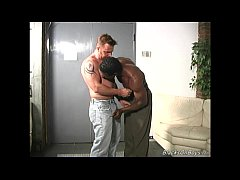 Muscular white guy makes love with a black man