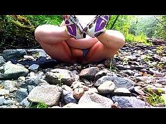 Fat Hippie redhead masturbating by a creek nake...