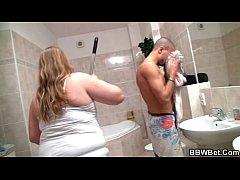 Horny guy fucks busty plumper in the bathroom