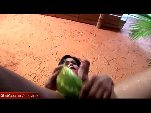 Slim tranny is riding watermelon glory hole and cums inside