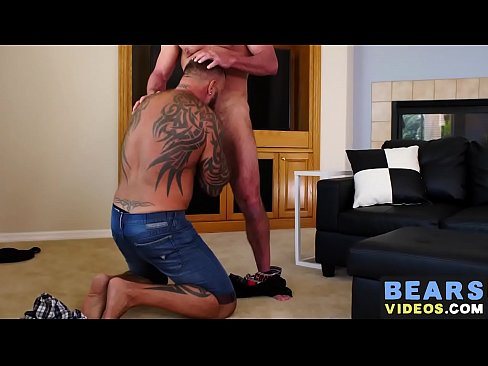 Inked bear barebacks ass after being rimmed