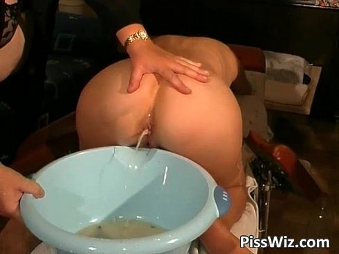Mature redhead slut pisses and gets wet