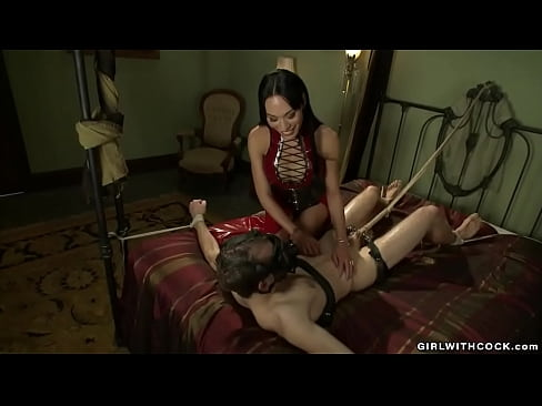 Shemale domme torments bound man