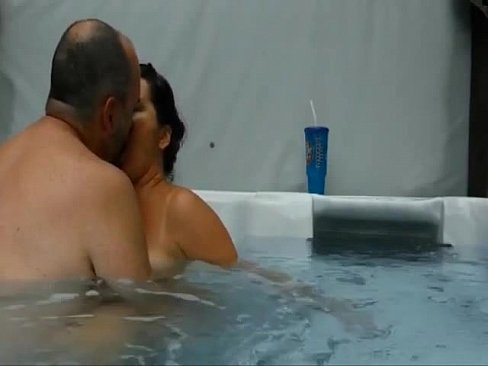 Mature couple having an amazing sex experience in their pool