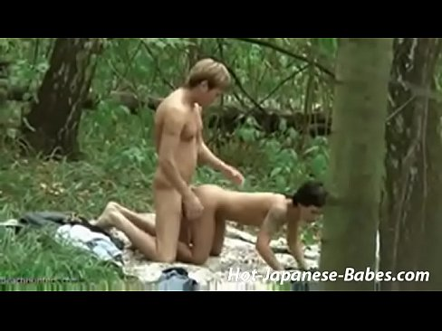 amateur couple having sex in forest
