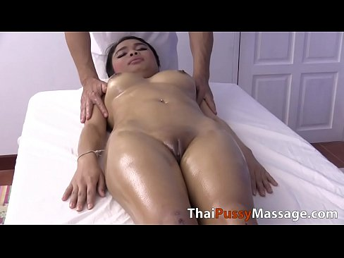 Big boob Asian girl finger fucked on massage table
