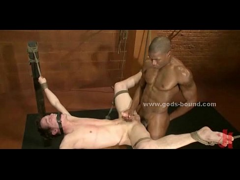 Strong Hunk Tied Near Cage Gets Spanked