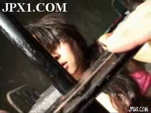 In chained asian prison women