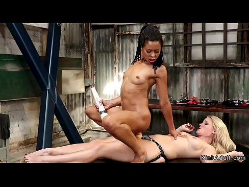 Ebony spinner anal rides huge strap on