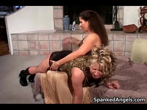 Attractive blonde gets bent over knees