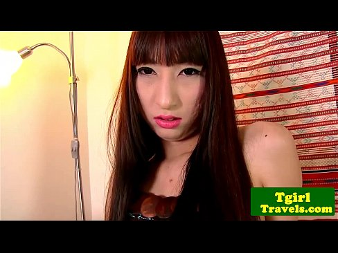 Ladyboy Polla plays with cock in couch's Thumb