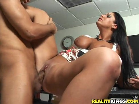 Angela Aspen bares her huge knockers and sucks on Voodoo's massive cock