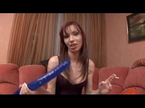 Redhead pornstar gets a double sided dildo forced in her throat
