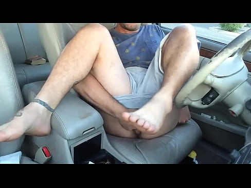 Hippie guy jerking off and fingering ass in the car in public
