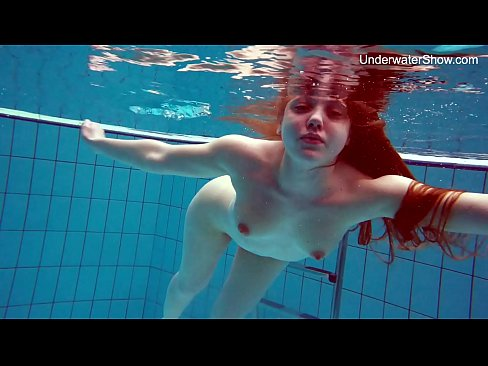Sweet redhead Simona shows off her sexy curves underwater