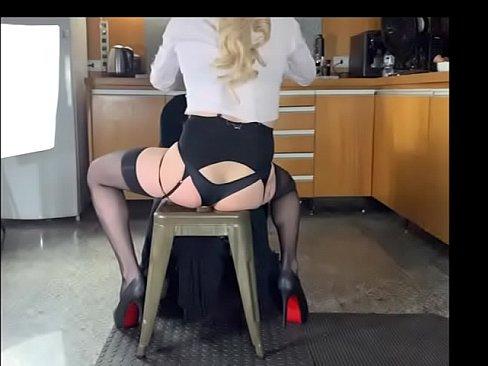 Dirty secretary riding an anal dildo