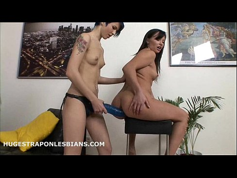 Amy fills Alisya's asshole with a huge strap-on dildo